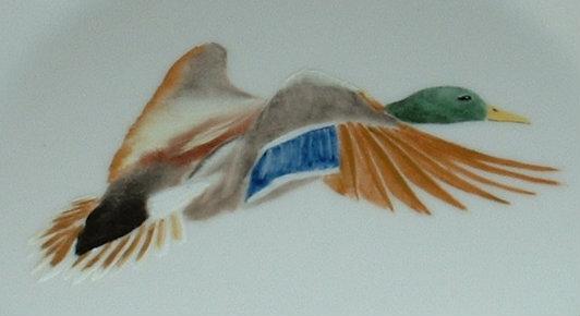 Assiette «canard en vol»