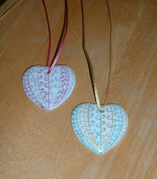 Collier coeur et arabesques
