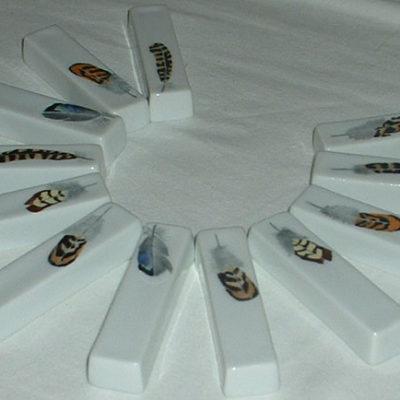 12 porte-couteaux plumes