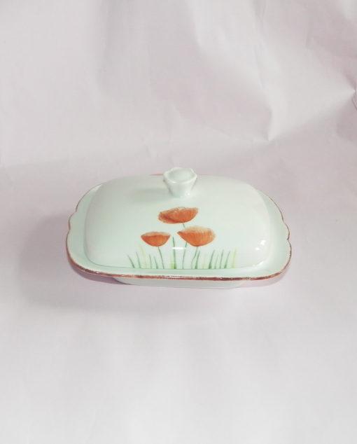 Grand beurrier décor coquelicots en porcelaine