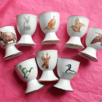 8 coquetiers en porcelaine décor gibier